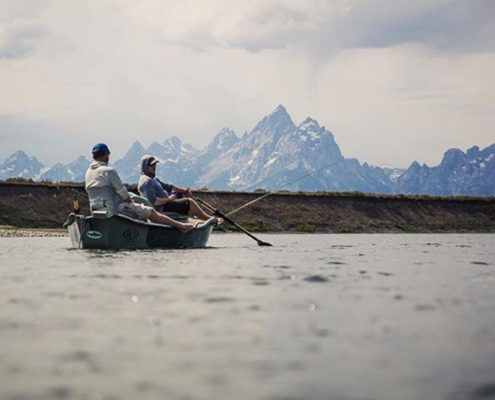 Fly fishing guides in a drift boat on the snake river